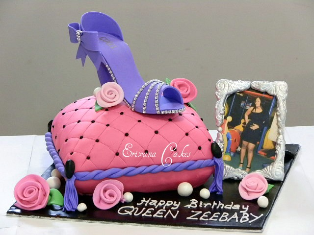 Pillow cake with shoe and photo album